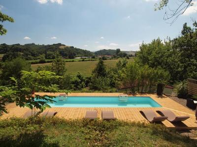 The 10 x 3m heated swimming pool with views of the surrounding countryside