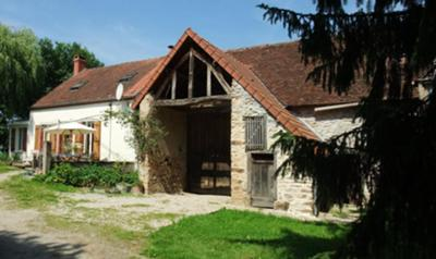 Two cottages with large barn in between