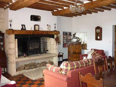 Lounge with character beams and wood burner