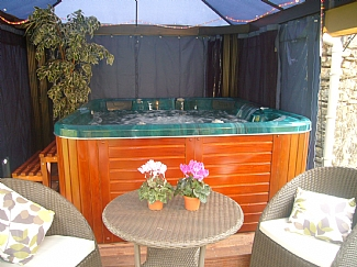 Sheltered hot tub for your exclusive use