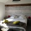 double bedroom with feature wallpaper