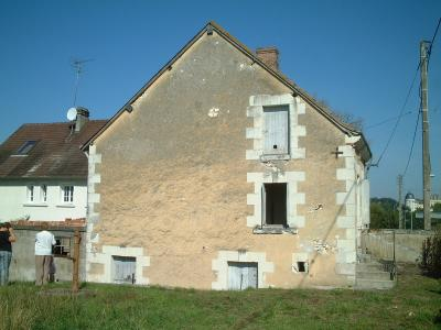 side view of house and garden with chateau in distance