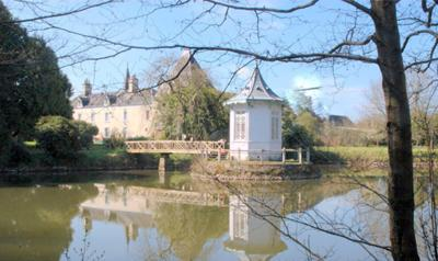 view of manoir from across the hand built carp lake