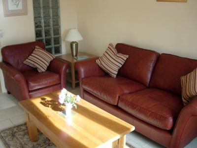 Deep, comfy sofa in front sitting room