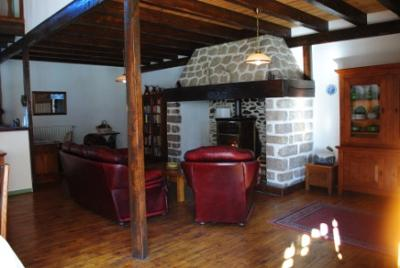 Interior showing fireplace, beams and floor